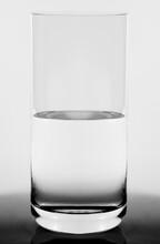Studio Shot Of  Glass Half Full Concept