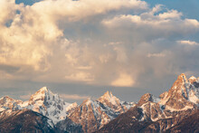United States, Wyoming, Snow Covered Teton Mountains At Sunrise