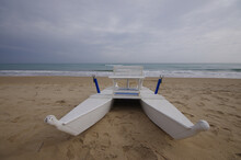 White Lifeboat On The Beach
