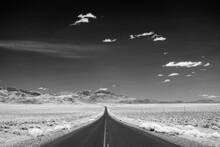United States, Oregon, Empty Road Crossing Desert Landscape