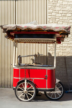 An Empty Red Chestnut Stall In Istanbul. The Tourist Crisis In Turkey. Indoor Street Food Kiosk