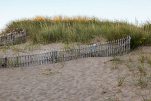 San Dunes With Wooden Fence