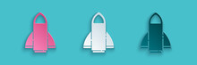 Paper Cut Rocket Ship Icon Isolated On Blue Background. Space Travel. Paper Art Style. Vector