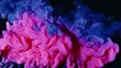 Blue pink acrylic paint spreading in water. Abstract background