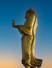 Big Golden Buddha Statue Against Blue Sky