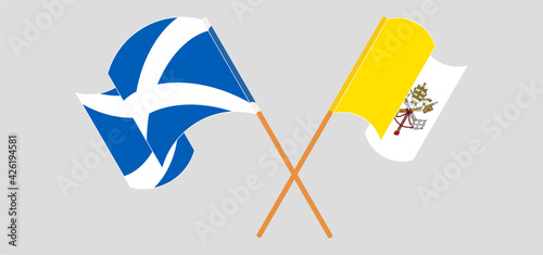 Foto Crossed and waving flags of Scotland and Vatican