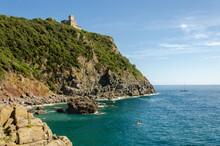 Cala Del Leone, Castel Sonnino Italy. Coast Castle On The Rock With The Sea. Tuscany