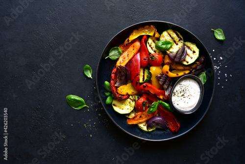 Billede på lærred Grilled vegetables with yogurt sauce. Top view with copy space.