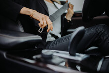 Close-up Image Of A Woman Fastening Seat Belt.