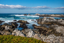 Waves Break Along The Rocky Coastal Shores Of The Monterey Bay At Asilomar Beach, In Pacific Grove, Along The Central Coast Of California.