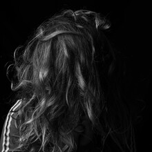 Vertical Grayscale Shot Of A Female's Messy Hair