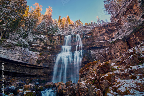 Beautiful Waterfall Vallesinella in Madonna di Campiglio in the autumn time, Nat Fotobehang
