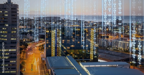 Composition of digital interface over a cityscape in background