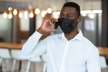 Casual African American Businessman Wearing Face Mask Talking On Smartphone