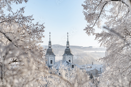 Little church in winter with two towers Fototapet