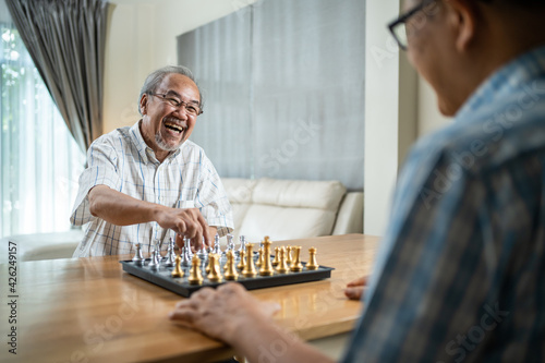 Slika na platnu Asian old man enjoy playing chess together with friend in nursing home