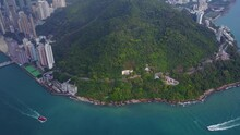 Mount Davis Green Forested Slope And Kennedy Town Aerial Shot Western HK Island