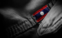 Tag On Dark Clothing In The Form Of The Flag Of The Laos
