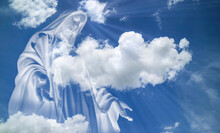 Close Up Of Mary In White Clouds With Light Ray From  Heaven. Religion,