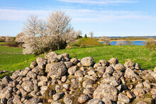 Beautiful Rural Landscape With A Stone Cairn On A Meadow