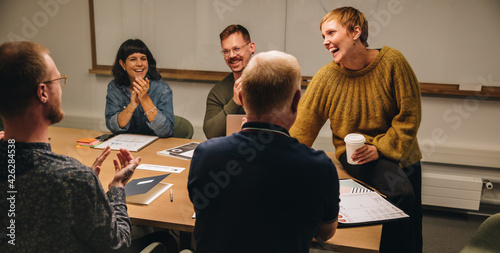 Fotografie, Obraz Businesswoman sharing good news in meeting