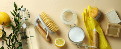 Obraz Cleaning concept with eco friendly cleaning tools and lemons on beige background - fototapety do salonu