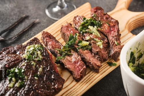 Fototapeta Hanger steak bbq with souce chimichurri, close up obraz