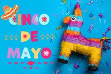 Cinco De Mayo Festive Poster. Bright Funny Pinata On Blue Background, Flat Lay