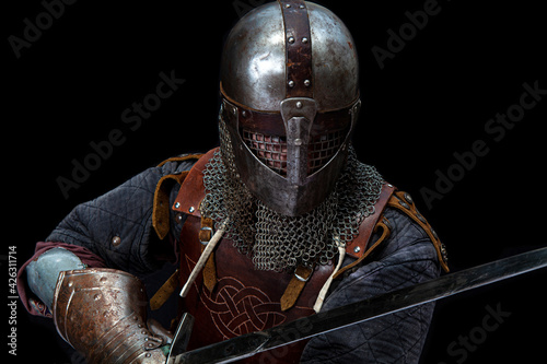 Canvastavla Young man in knight armor on black background