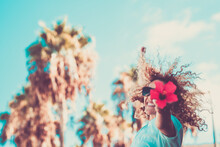 Spring Beautiful Nature Concept And Happy Free Woman Lifestyle With Young Adult People Female Jumping And Holding Big Red Flower - Joyful Life Portrait