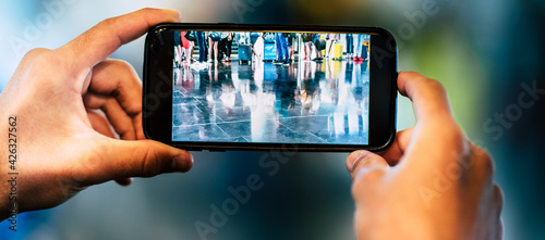 Fotografia Close up of people taking picture with smartphone