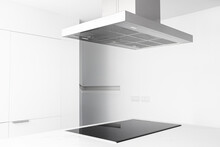 View Of A Cooker Hood And Electric Stove Of A Modern And Minimalist Kitchen