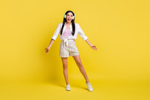 Full Length Photo Of Excited Happy Young Woman Music Lover Wear Headphones Isolated On Yellow Color Background