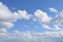 Beautiful View Of White Fluffy Clouds On A Blue Sky - Perfect For Wallpaper