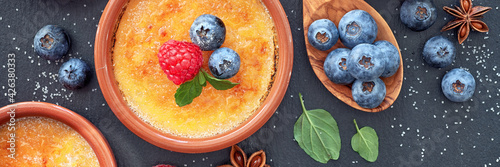 Creme brulee (cream brulee, burnt cream) with raspberry, blueber Fototapeta