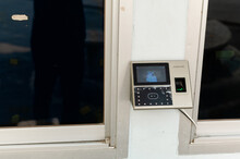The Fingerprint Scanner With Clock On The Wall. Equipment For Working Time In Office.