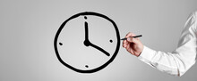 Businessman Draws A Clock Icon On Gray Background. Business Or Project Time Management