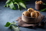 Fototapeta Kawa jest smaczna - Scoops of coffee or chocolate ice cream in a bowl with green leaves on dark background