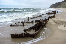 The Remains Of A Seagoing Vessel On The Shore. Old Rusty Ship. The Rusted Wreckage Of An Old Ship.