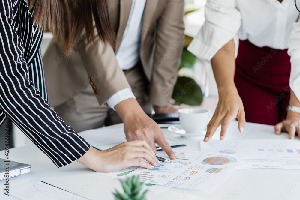 Fototapeta Hand of team, group young businessman,businesswoman people working marketing plan,discussing on paperwork with teamwork,colleagues at office,workplace.Brainstorm business concept.