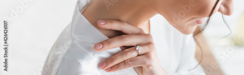 cropped view of smiling bride in wedding ring, banner.