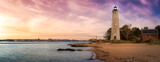 Panoramic view on a lighthouse on the Atlantic Ocean Coast. Colorful Sunrise Sky Art Render. Taken in Lighthouse Point Park, New Haven, Connecticut, United States.