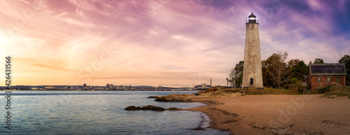 Panoramic view on a lighthouse on the Atlantic Ocean Coast. Colorful Sunrise Sky Art Render. Taken in Lighthouse Point Park, New Haven, Connecticut, United States. - fototapety na wymiar