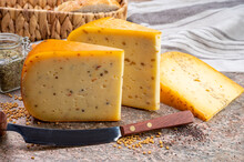 Cheese Collection, Pieces Of Hard Yellow Dutch Gouda Cheese With Dried Caraway, Mustard, Cumin, Fenugreek, Pepper Seeds