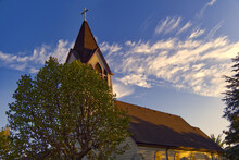 Church Beneath Wispy Clouds In Central California