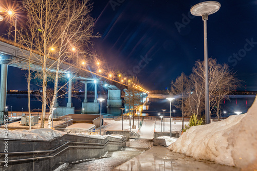 Fotografie, Tablou The embankment in Perm in winter, the Kama River in the evening twilight