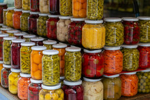 Various Preserved Pickled Vegetables In Glass Jars. Marinated Food And Organic Raw Vegetables, Canned Homemade Food Concept. Preservation And Storage Of Vegetarian Food For The Winter