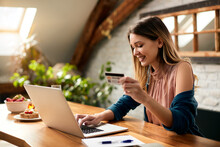 Young Happy Woman E-shopping With Credit Card And Laptop At Home.