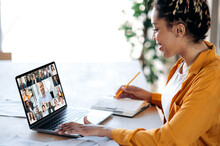 Inline Briefing, Conference. African American Female Manager Communicates With Business Team During Video Call, Listens Financial Webinar, Takes Notes, On Laptop Screen Friendly Multiracial People