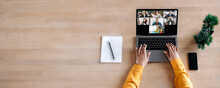 Business Briefing, Online Education, Webinar. Top View On Laptop Screen On The Desk With Multiracial People Gathered Together To Communicate Or Learning Distantly By Video Conference. Copy Space